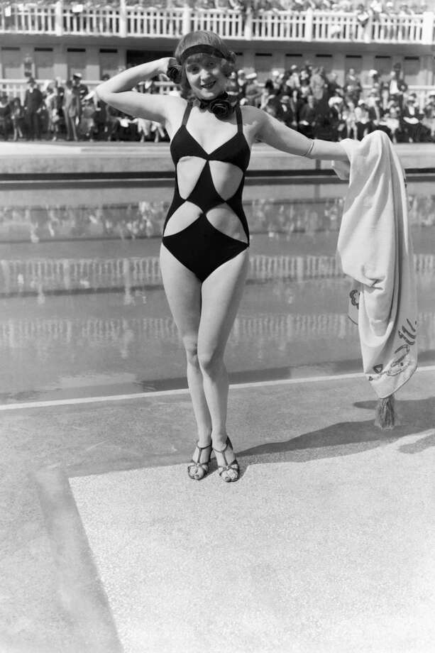 "Woman wearing a funny bathing suit at the Aquatic gala at Molitor swimming pool, on June 23, 1931 in Paris, France. Of course, that ""funny"" bathing suit with strategic cutouts is quite common these days. Photo: Keystone-France, Gamma-Keystone Via Getty Images"