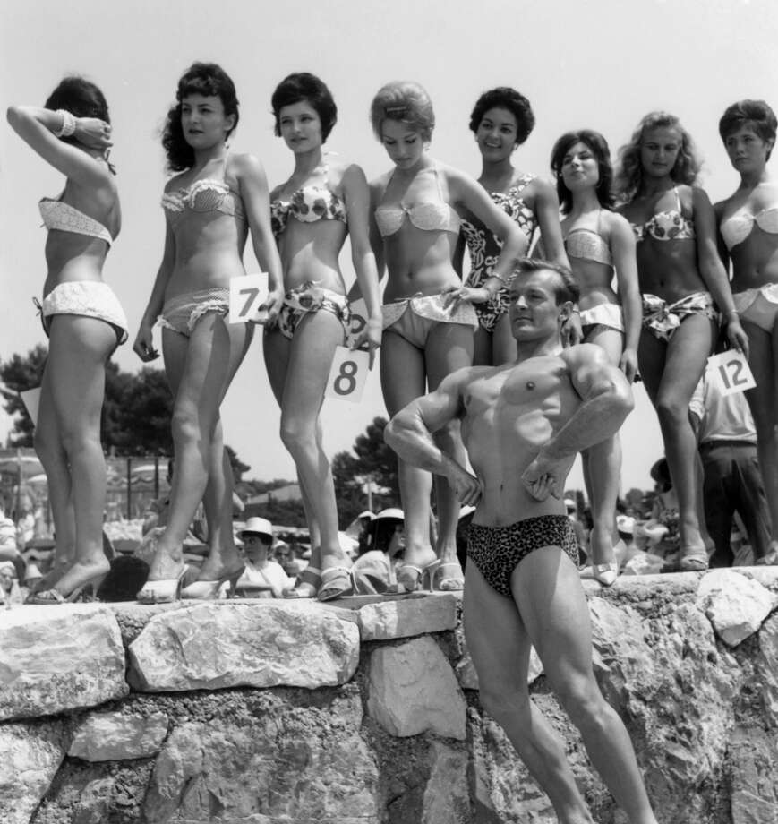 Mr Universe poses with the Miss Festival candidates during the Cannes Film Festival, May 10, 1960. Photo: RDA/Hulton Archive, Getty Images