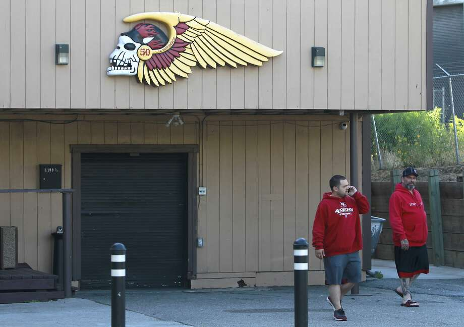 Unidentified men leave the Hells Angels clubhouse after a predawn raid by police officers in S.F. Photo: Paul Chinn, The Chronicle
