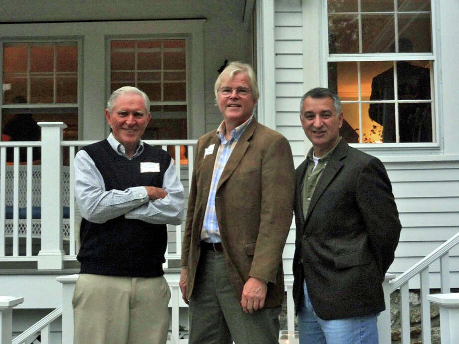 State Sen. Carlo Leone, D-27, right, and Darien Land Trust President Chris Filmer, left, joined Friends of Gorham's Pond President John Lundeen, center, and more than 50 Darien residents at a reception to benefit the group and its projects, including the dredging of Upper Pond. Photo: File Photo / Darien News