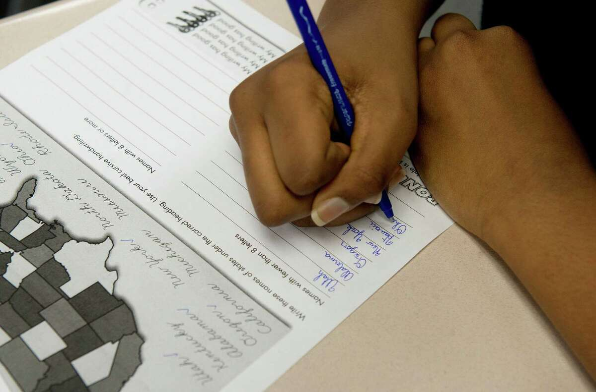 Shanika Duverneau practices cursive writing at Our Lady Star of the Sea School in Stamford on Thursday, May 8, 2014.