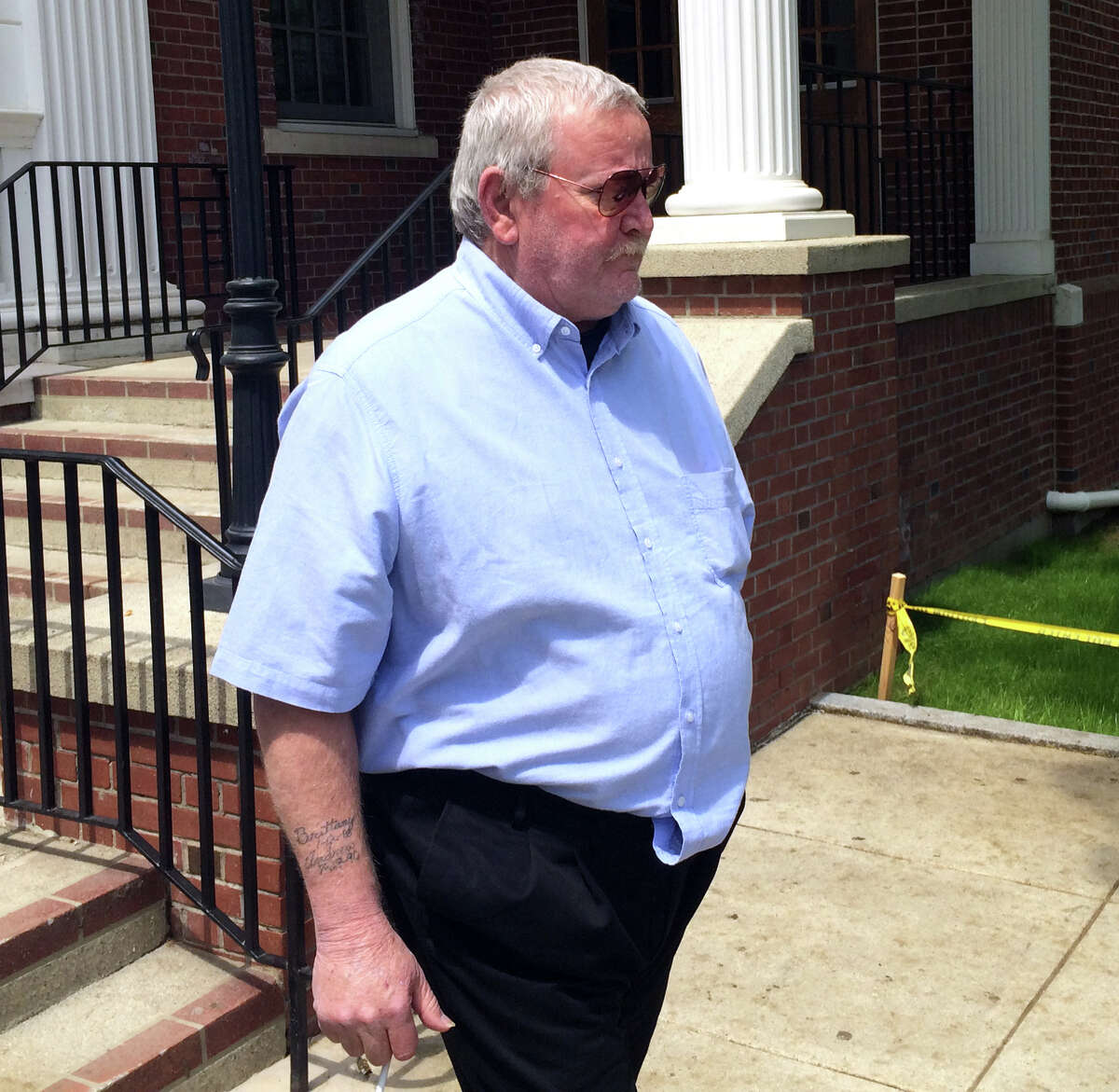 Arthur Gauvin, who allegedly held his sister captive in a room of their Seymour home for several years, leaves Milford Superior Court following a court appearance May 14, 2014.