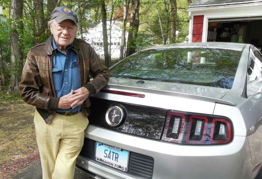 Robert Satter, a World War II veteran, outside his Sue Terrace home wearing the flight jacket he wore in 1944 during dozens of combat missions over Germany and occupied France. Satter, 90, is serving as this year's Memorial Day Parade Grand Marshal. Photo: Anne M. Amato / westport news