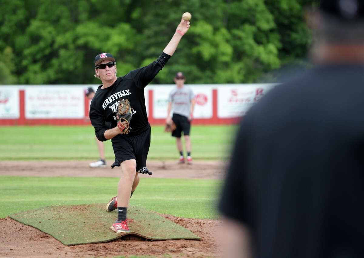 Jackson Gore throws from the pitcher's mound during practice Tuesday afternoon. The Kirbyville High School baseball team practiced Tuesday in preparation for the regional quarterfinals against Central Heights High School. Photo taken Tuesday 5/13/14 Jake Daniels/@JakeD_in_SETX