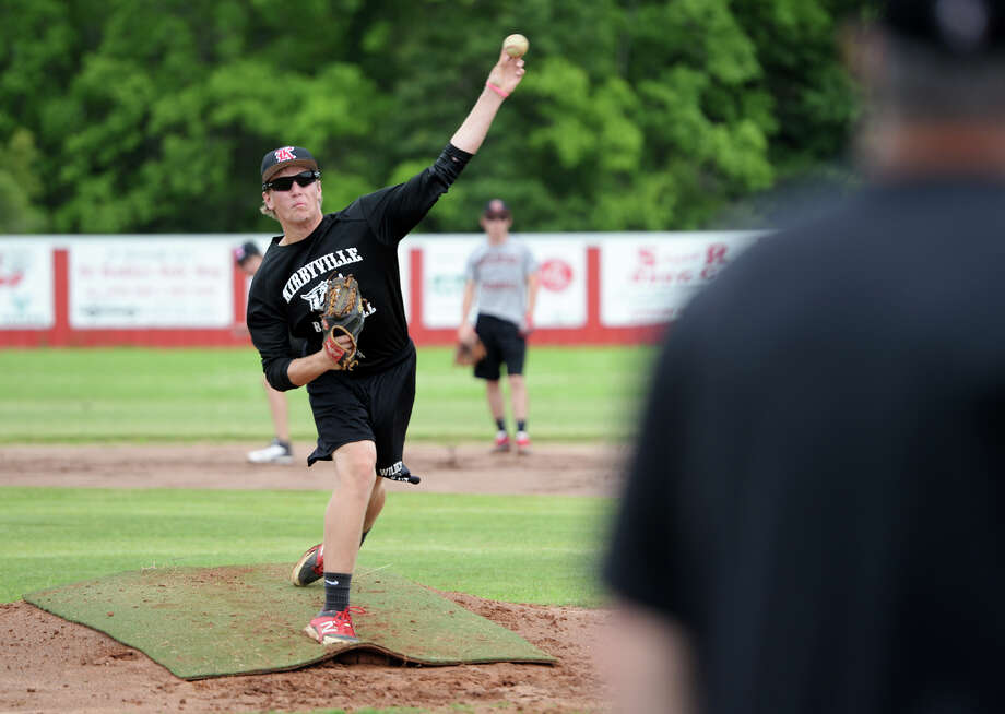 Jackson Gore throws from the pitcher's mound during practice Tuesday afternoon. The Kirbyville High School baseball team practiced Tuesday in preparation for the regional quarterfinals against Central Heights High School. Photo taken Tuesday 5/13/14 Jake Daniels/@JakeD_in_SETX Photo: Jake Daniels / ©2014 The Beaumont Enterprise/Jake Daniels