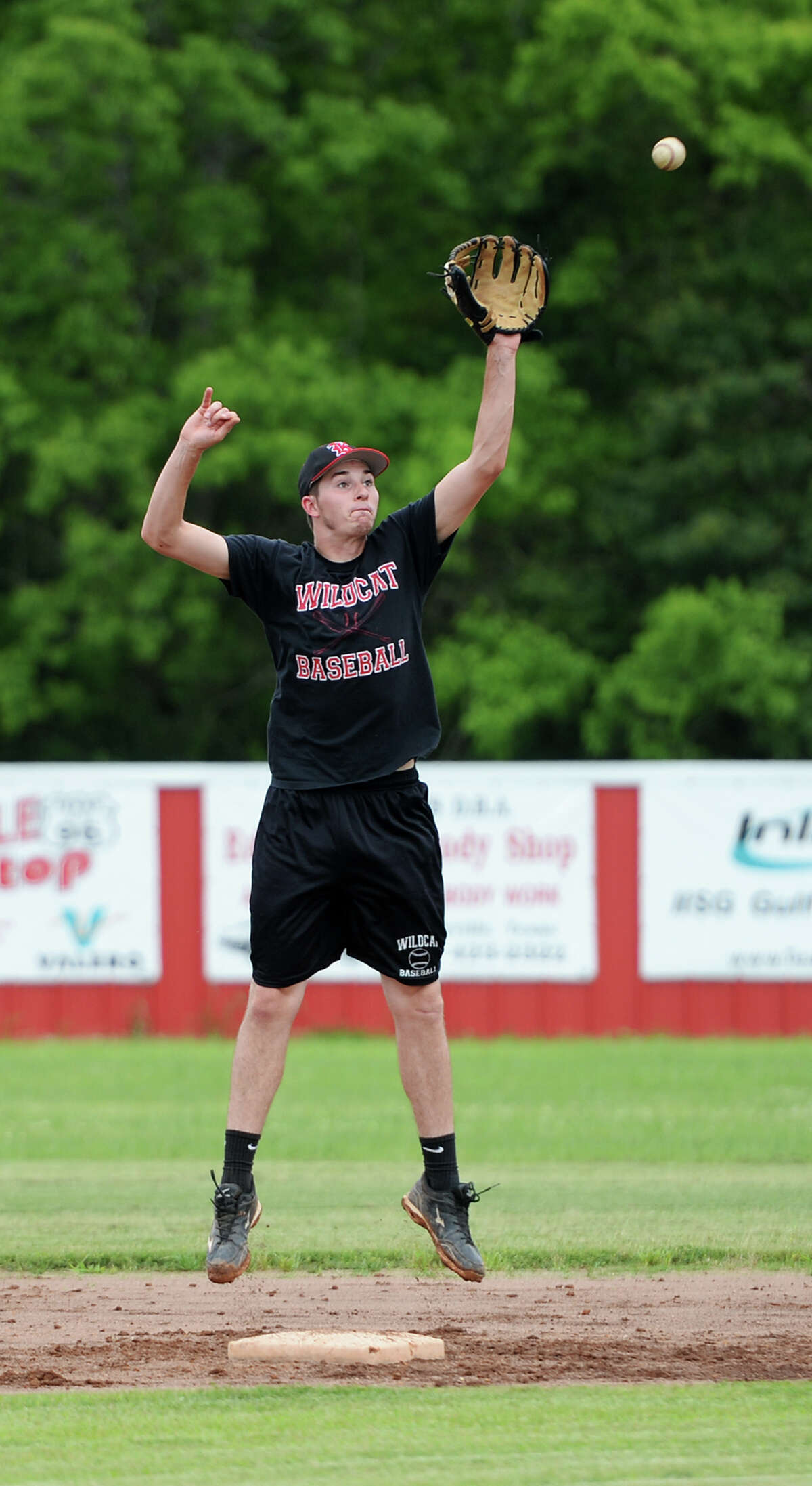 Kevin Self leaps up for a catch at second base during practice on Tuesday afternoon. The Kirbyville High School baseball team practiced Tuesday in preparation for the regional quarterfinals against Central Heights High School. Photo taken Tuesday 5/13/14 Jake Daniels/@JakeD_in_SETX