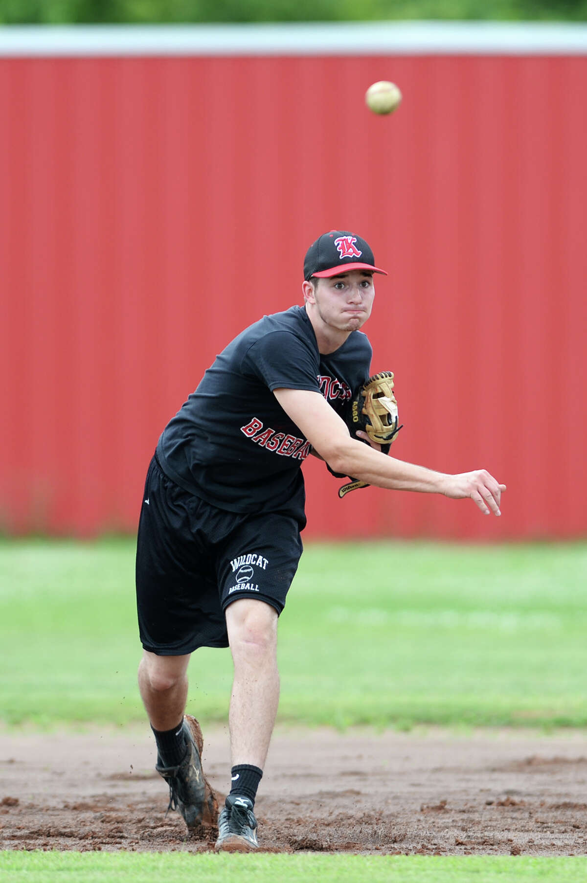 Kevin Self throws to a teammate during practice on Tuesday afternoon. The Kirbyville High School baseball team practiced Tuesday in preparation for the regional quarterfinals against Central Heights High School. Photo taken Tuesday 5/13/14 Jake Daniels/@JakeD_in_SETX