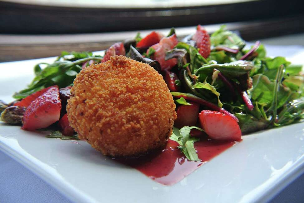 A strawberry salad with candied pistachios and pan fried goat cheese is a revamped menu option for Normanside Country Club's restaurant, One Six Five. (Deanna Fox)