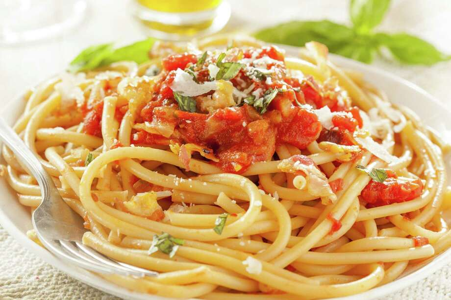 Homemade Bucatini Amatriciana Pasta with sauce and basil Photo: Brent Hofacker / Brent Hofacker - Fotolia