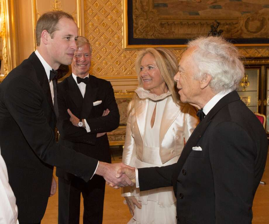 Prince William, Duke of Cambridge, left, speaks with Ralph Lauren at a dinner to celebrate the work of The Royal Marsden at Windsor Castle, England, Tuesday evening, May 13, 2014. Photo: Doug Seeburg, Associated Press