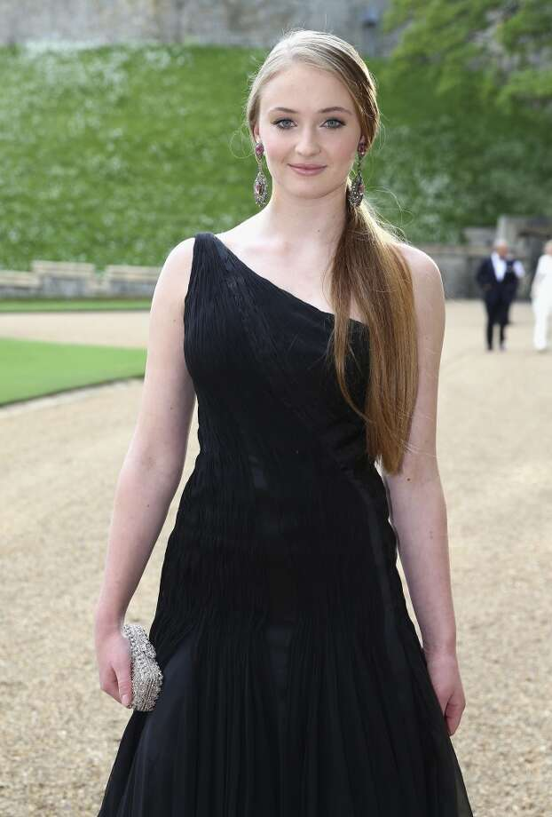 British actress Sophie Turner arrives for a dinner to celebrate the work of The Royal Marsden hosted by Prince William, the Duke of Cambridge at Windsor Castle in Windsor on May 13, 2014. Photo: CHRIS JACKSON, AFP/Getty Images