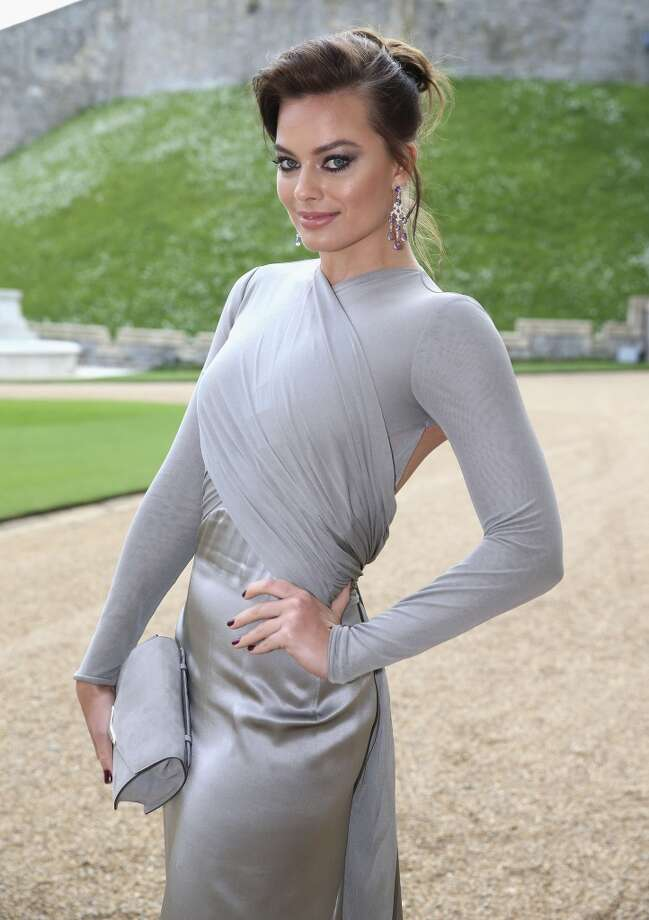 Australian actress Margot Robbie  poses for photographs as she arrives for a dinner to celebrate the work of The Royal Marsden hosted by Prince William, the Duke of Cambridge at Windsor Castle in Windsor on May 13, 2014. Photo: CHRIS JACKSON, AFP/Getty Images