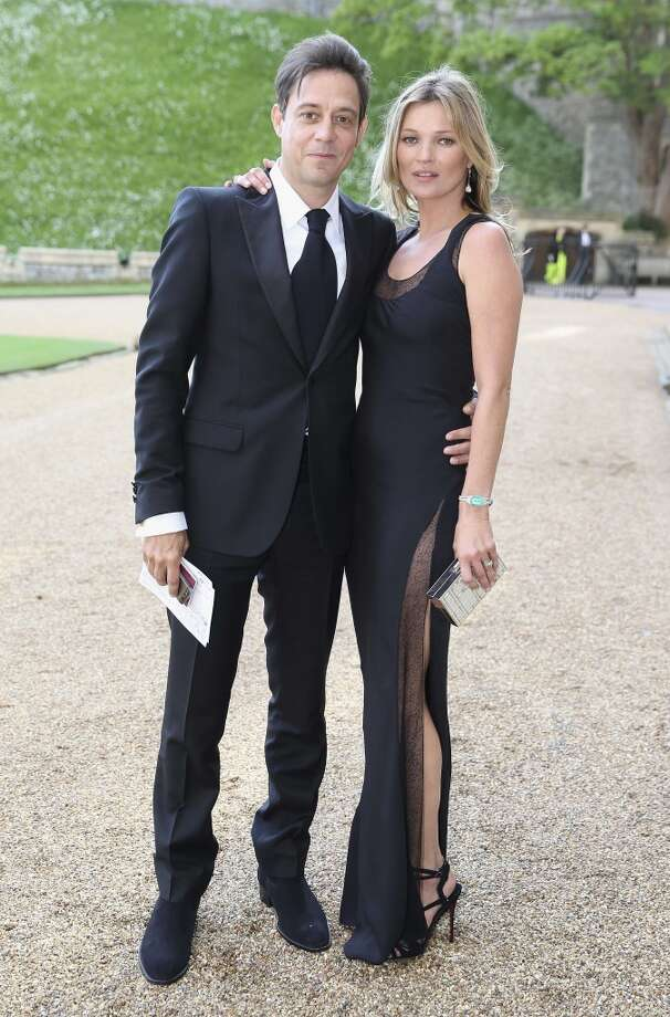 British model Kate Moss (R) and her husband British musician Jamie Hince arrive for a dinner to celebrate the work of The Royal Marsden hosted by Prince William, the Duke of Cambridge at Windsor Castle in Windsor on May 13, 2014. Photo: CHRIS JACKSON, AFP/Getty Images