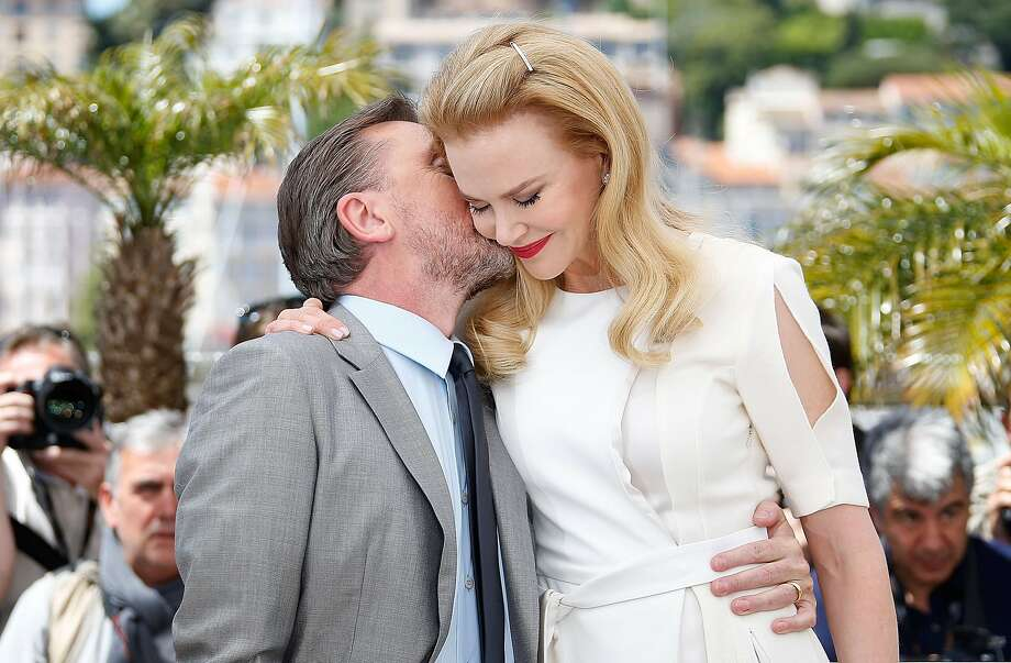 Don't tell Keith: Tim Roth kisses the much taller Nicole Kidman during a photo call for 
