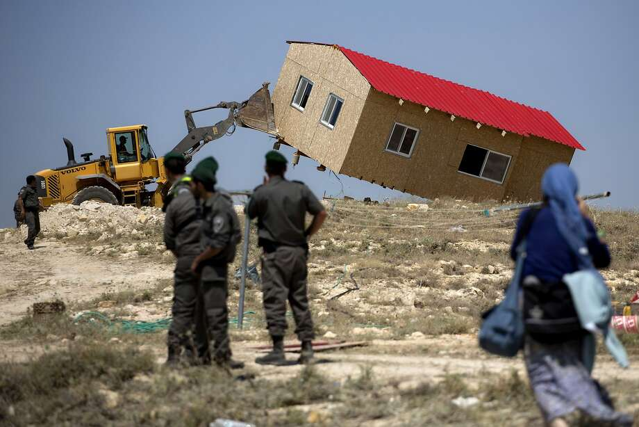 Israelis raze a settlement:Israeli border police stand guard as a settler's house is demolished in the West Bank Jewish 