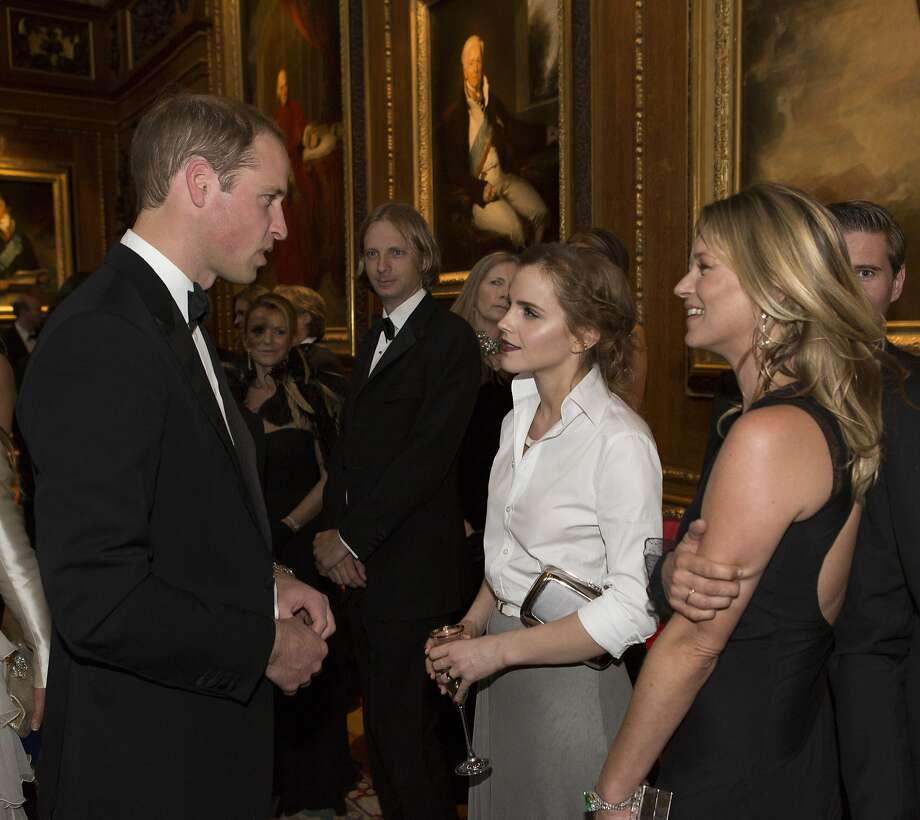 When the duchess is away, the duke will ... chat up Emma Watson and Kate Moss at a dinner celebrating the work of The Royal Marsden in Windsor, England. Photo: Doug Seeburg, Getty Images