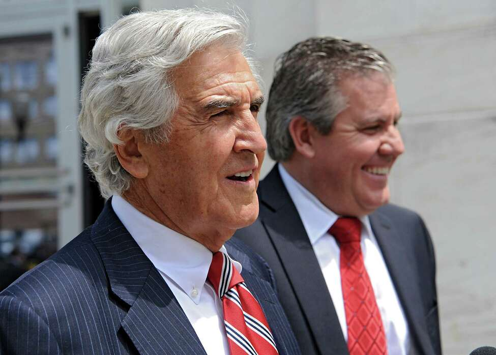 Former state Senate Majority Leader Joseph L. Bruno leaves the James T. Foley U.S. Courthouse with his son and attorney Ken Bruno, right, on Wednesday, May 14, 2014 in Albany, N.Y. (Lori Van Buren / Times Union)