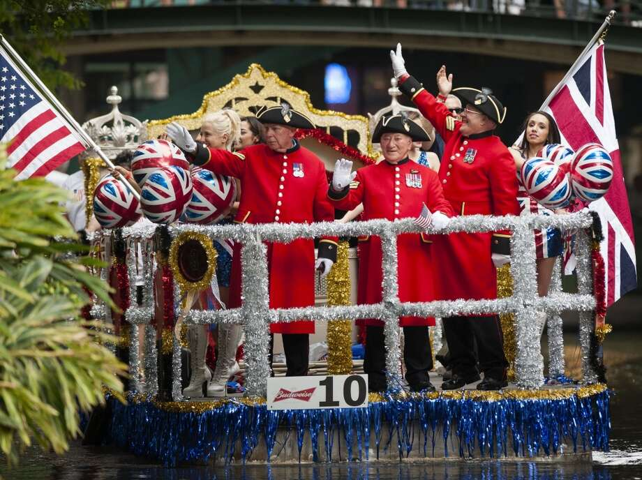Chelsea pensioners wave to spectators during last year's America's Armed Forces River Parade. Photo: Express-News, File