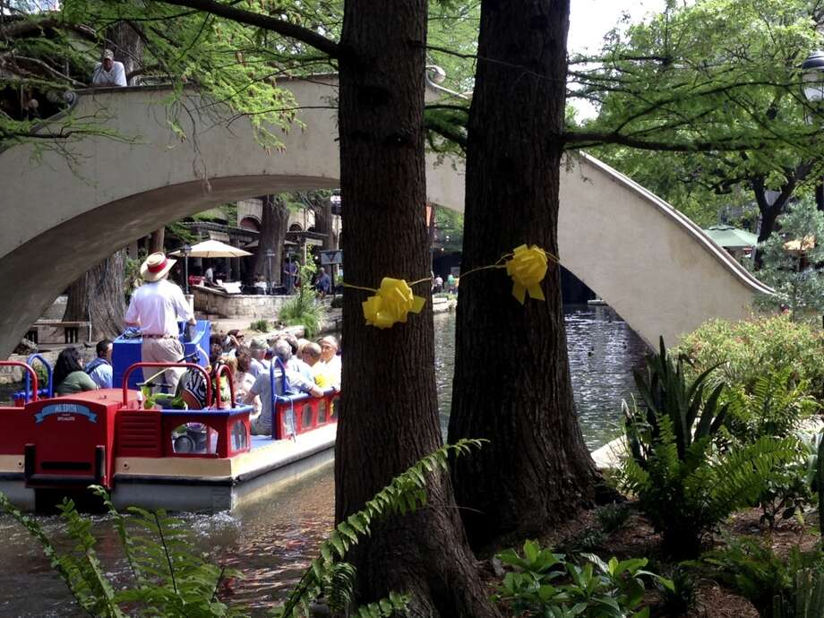 In 2013, the River Walk was decorated with more than 200 yellow ribbons for the second annual America's Armed Forces River Parade. Photo: Courtesy, File