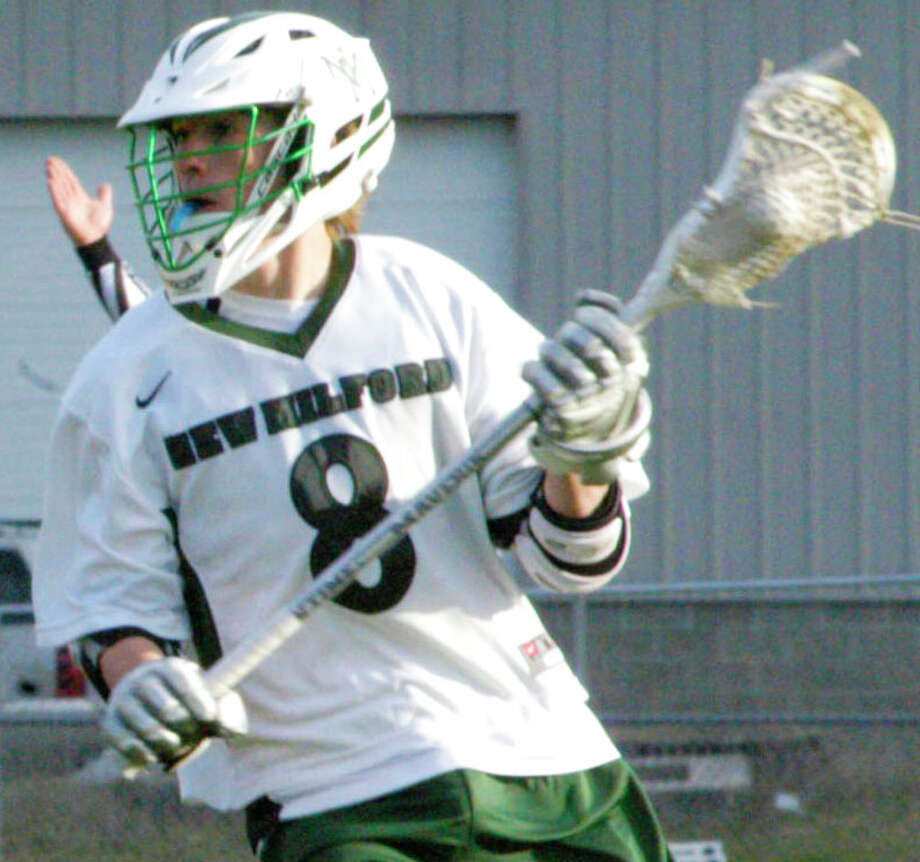 Blaine McMahon, shown here during New Milford High School boys' lacrosse's 11-6 victory over Weston, April 28,2014 at NMHS, and his Grreen Wave teammates have set their sights high this spring. Photo: Norm Cummings / The News-Times
