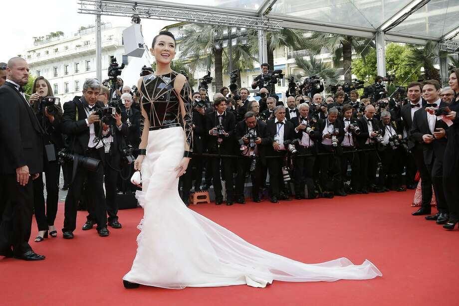 Zhang Ziyi - This dress is amazing and fascinating. But we'd be too scared to touch it. It might eat us, too.  Photo: Thibault Camus, Associated Press
