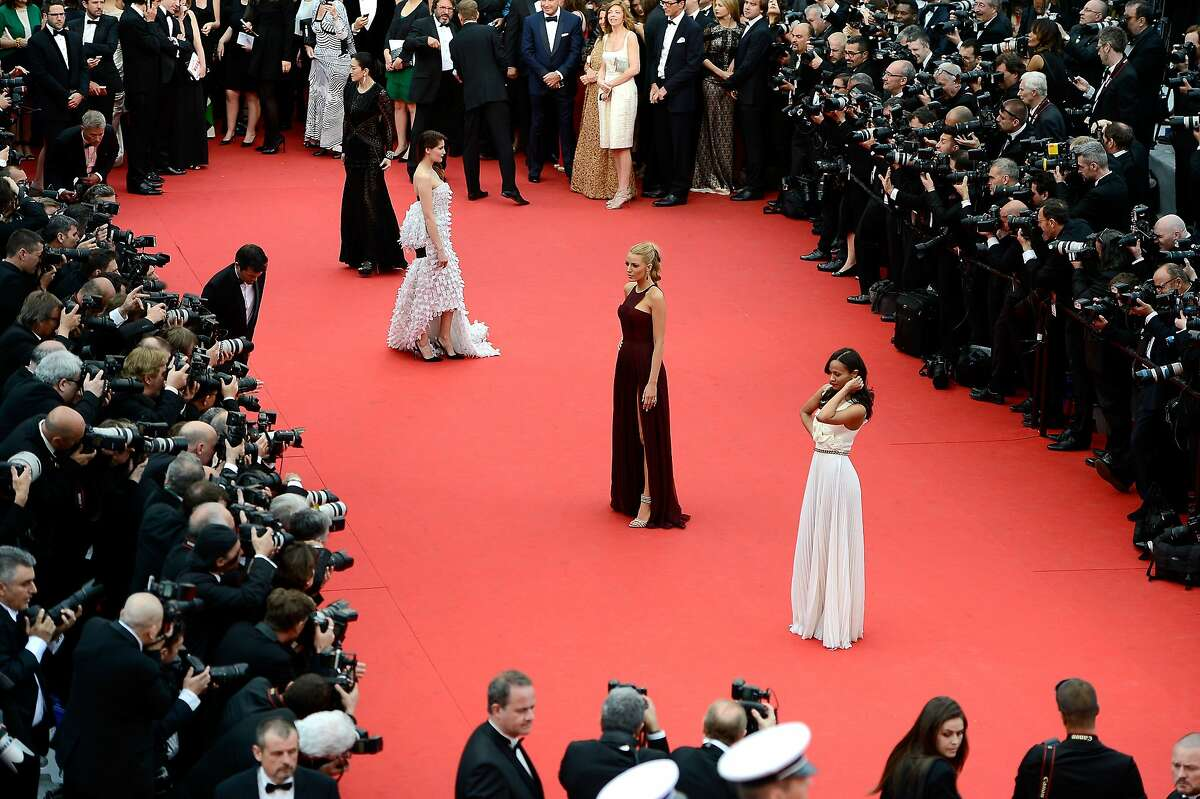 Zoé Saldana (R), Blake Lively (C) and Laetitia Casta attend the Opening ceremony and the