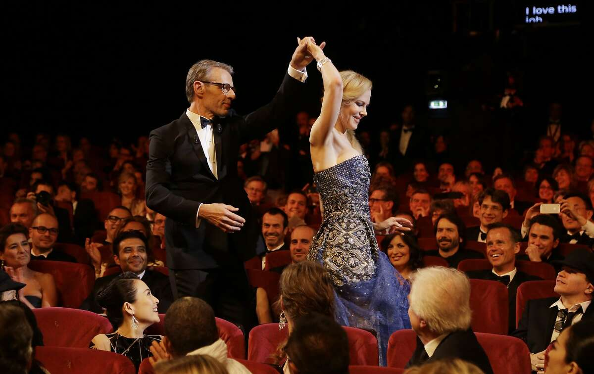 Master of Ceremonies Lambert Wilson, left, and actress Nicole Kidman during the opening ceremony ahead of the screening of Grace Of Monaco at the 67th international film festival, Cannes, southern France, Wednesday, May 14, 2014.