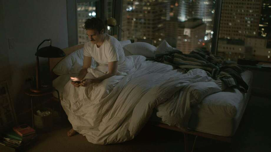 "In an undated handout photo, Joaquin Phoenix plays a divorcee deeply in love with Samantha, his computer-operating system, in ""Her."" Next-generation sex toys run the gamut from interactive dating simulators to internet-compatible vibrators, but for now, the digital world's biggest mark on sexuality may be the person-to-person apps enabling hookup culture. (Warner Bros. Pictures via The New York Times) -- NO SALES; FOR EDITORIAL USE ONLY WITH STORY SLUGGED DIGITAL-HOOKUPS BY HAGWOOD. ALL OTHER USE PROHIBITED. ORG XMIT: XNYT47 Photo: WARNER BROS. PICTURES / (c) MMXIII Untitled Rick Howard Company LLC"