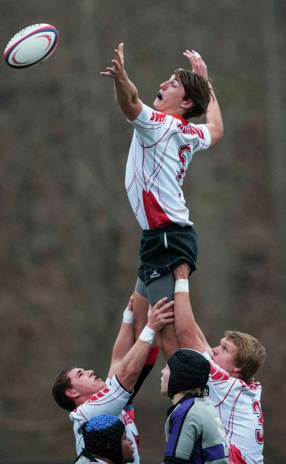 Greenwich high School's Parker Kelly gets lifted up by his teammates on a lineout during a rugby match against New Rochelle high school played at Greenwich high school, Greenwich, CT on Friday, March, 28th, 2014. Photo: Mark Conrad / Connecticut Post Freelance
