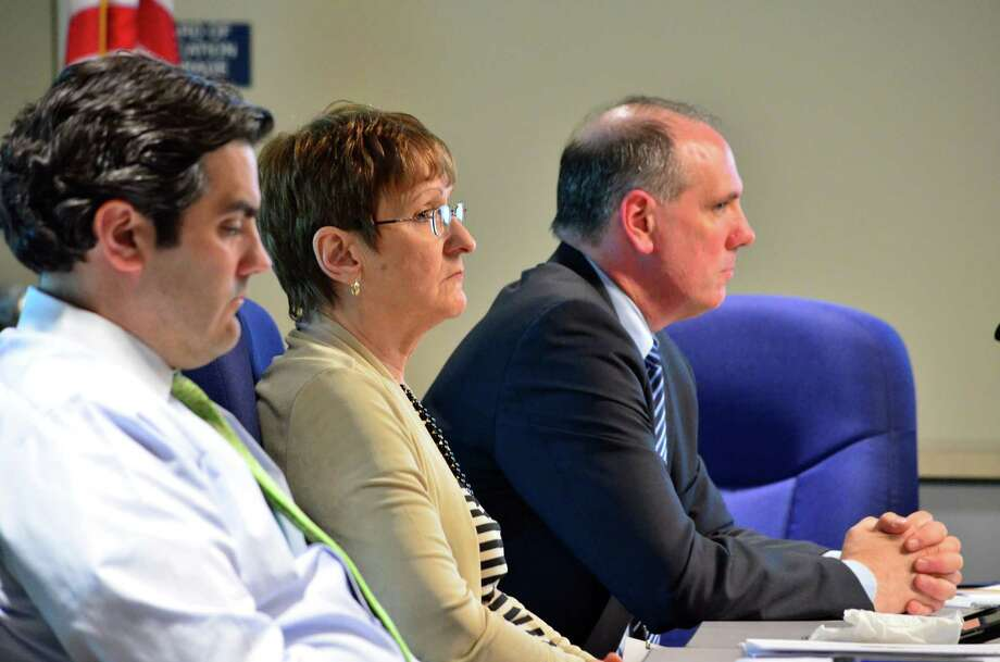 Director of Finance Michael Feeney, from left, Assistant Superintendent of Elementary Education Judith Pandolfo and Assistant Superintendent of Secondary Schools Tim Canty listened to the new organization of the Darien Public Schools administration on Tuesday, May 13. Photo: Megan Spicer / Darien News