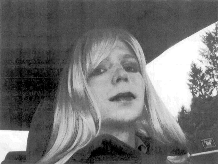 FILE - In this undated file photo provided by the U.S. Army, Pfc. Chelsea Manning poses for a photo wearing a wig and lipstick. In an unprecedented move, the Pentagon is trying to transfer convicted national security leaker Pvt. Chelsea Manning to a civilian prison so she can get treatment for her gender disorder, defense officials said Tuesday May 13, 2014.  (AP Photo/U.S. Army, File) Photo: Uncredited, HOPD / Associated Press / U.S. Army
