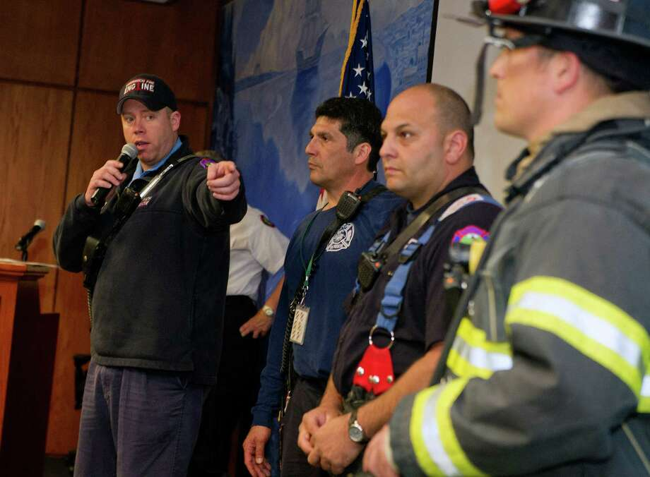 Greenwich firefighters participate in a uniform fashion show at Greenwich Town Hall on Wednesday, May 14, 2014, in honor of Older Americans Month. Representatives from multiple state and local agencies displayed their uniforms to help seniors spot imposters. Photo: Lindsay Perry / Stamford Advocate