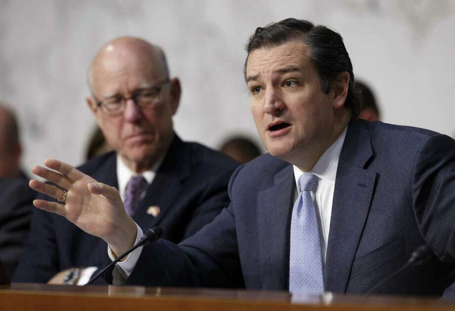 Sen. Ted Cruz, R-Texas (right), has defended withholding the identity of contributors by so-called nonprofits that participate in political campaigns, but the public should know who is involved in electioneering in a democracy. Photo: Associated Press File Photo / AP
