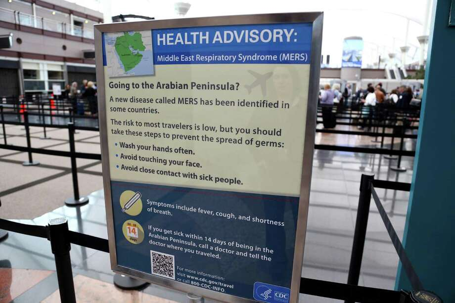 The first laboratory confirmed case of the virus in the United States was reported in Indiana on May 2 after an individual traveled to Saudi Arabia. A second case was reported in Florida a week later. Signs like these have been erected at airports across the country since those reported cases. Photo: Denver International Airport, AP / Denver International Airport
