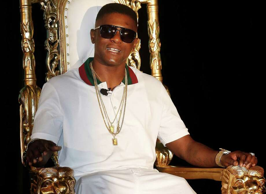 In this March 10, 2014 file photo, rapper Lil' Boosie, whose real name is Torence Hatch, appears at a news conference in New Orleans. For the first time since his prison stint, Hatch, 31, takes the stage in his home state this weekend with performances scheduled in Lafayette and New Orleans. (AP Photo/Bill Haber, File) FILE - In this March 10, 2014 file photo, rapper Lil' Boosie, whose real name is Torence Hatch, appears at a news conference in New Orleans. For the first time since his prison stint, Hatch, 31, takes the stage in his home state this weekend with performances scheduled in Lafayette and New Orleans. (AP Photo/Bill Haber, File)   MARCH 10 2014 FILE PHOTO Photo: Bill Haber, FRE / FR170136 AP