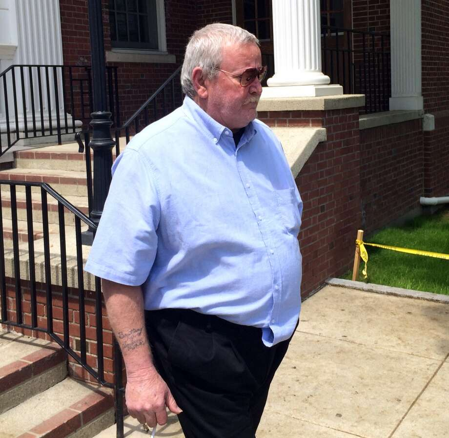 Arthur Gauvin, who allegedly held his sister captive in a room of their Seymour home for several years, leaves Milford Superior Court following a court appearance May 14, 2014. Photo: Michael P. Mayko