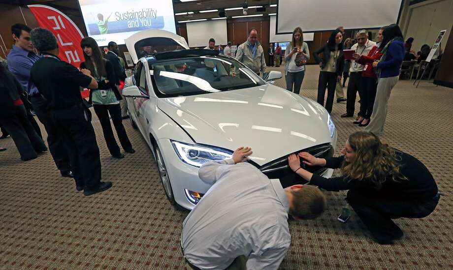 Telsa's electric cars won't be the only devices using lithium-ion batteries, CEO Elon Musk says. Solar-power units will also rely on the technology. Photo: Bruce Bisping, McClatchy-Tribune News Service