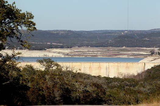 Medina Dam is seen from Old Medina Dam Road south of the dam, Tuesday, Feb. 4, 2014.  Photo: Jerry Lara, San Antonio Express-News / ©2013 San Antonio Express-News