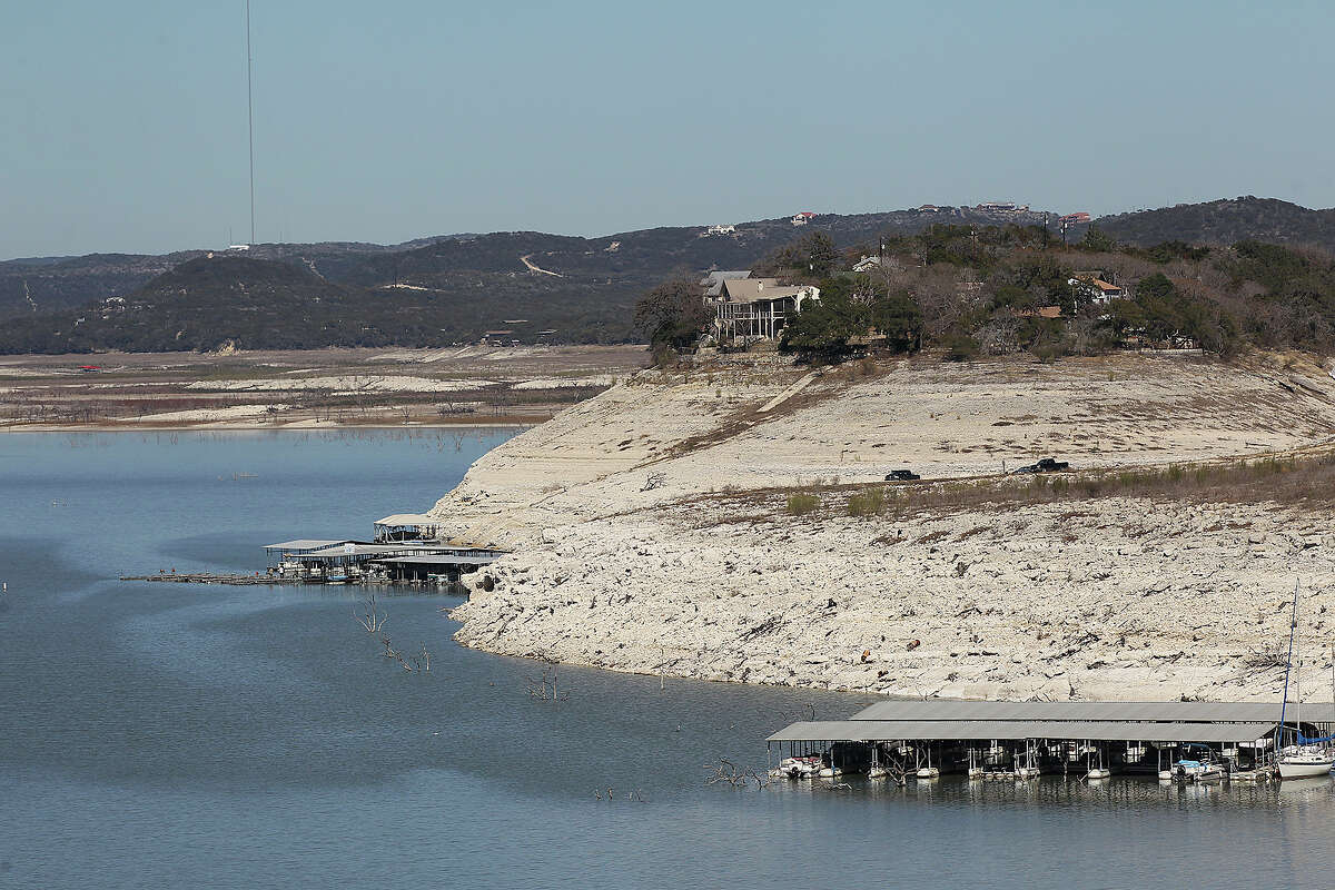 The dropping level of Medina Lake is marked by exposed land in this view from Medina Dam, Tuesday, Feb. 4, 2014. According to today's reading by the Texas Water Development Board, the lake is at 3.5-percent capacity.