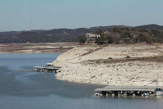 The dropping level of Medina Lake is marked by exposed land in this view from Medina Dam, Tuesday, Feb. 4, 2014. According to today's reading by the Texas Water Development Board, the lake is at 3.5-percent capacity. Photo: Jerry Lara, San Antonio Express-News / ©2013 San Antonio Express-News
