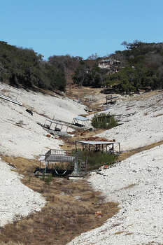 Boat docks are left high and dry as Medina Lake levels continue to drop, Tuesday, Feb. 4, 2014.  Photo: Jerry Lara, San Antonio Express-News / ©2013 San Antonio Express-News