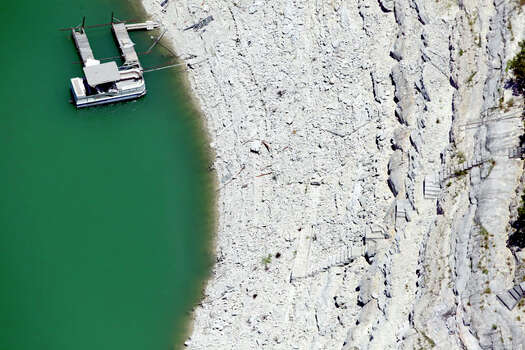 Medina Lake is seen in a Wednesday Aug. 1, 2012 aerial image. The Texas Water Development Board's website reports the lake is 59.39 feet low and is currently only 16.22 percent full Photo: William Luther / © 2012 San Antonio Express-News