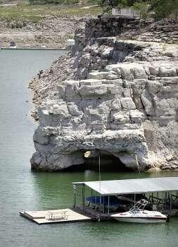 Medina Lake is still dropping. The arch at the base of this cliff is more and more exposed. Monday, July 2, 2012. Photo: BOB OWEN, Express-News / © 2012 San Antonio Express-News
