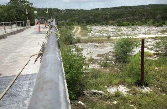 A flood gauge can be seen, right, in the overflow spillway of Medina Lake, Monday, July 2, 2012. Photo: BOB OWEN, Express-News / © 2012 San Antonio Express-News