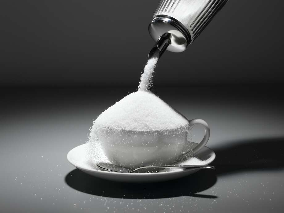 """16. The average American eats 152 pounds of sugar in a year. (Argentina is a  distant second at about 105 pounds per capita.) In 1973, South  African diabetes specialist George Campbell suggested that anything  more than 70 pounds per person per year would spark epidemics. (Mother Jones """"Sugar Industry Lies."""") To reach that mark, we would have to cut our sugar intake by more than half. (Diamond Sky Images/Getty Images)"""