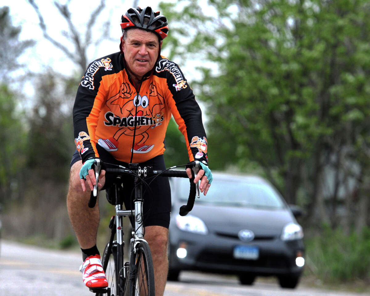Doug Fried rides his bicycle along Pequot Ave. as he returns home in the Southport section of Fairfield, Conn. on May 14, 2014. Fried commutes by bicycle to and from work in Stamford most days.