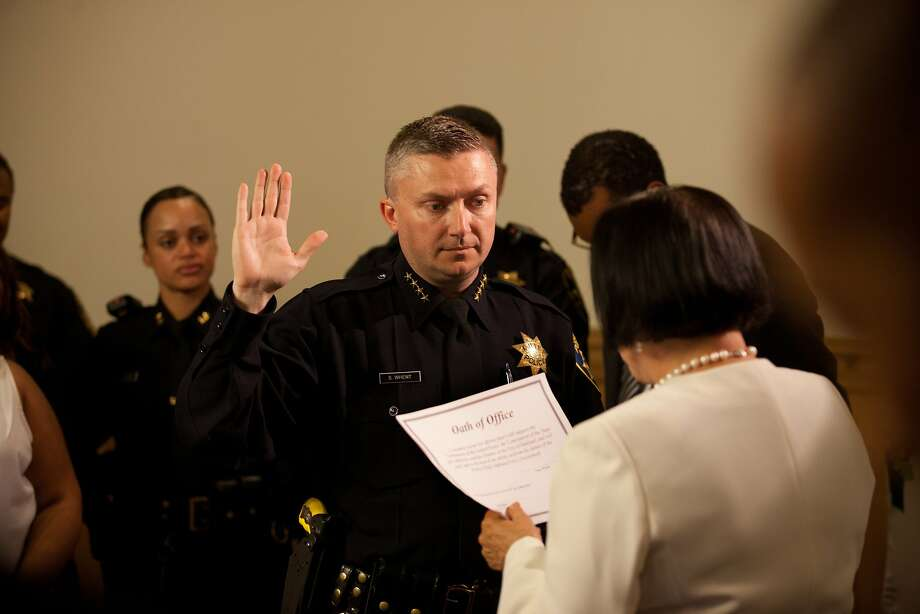 Sean Whent is sworn in by Mayor Jean Quan as the permanent police chief of Oakland, a job he held on an interim basis for the past year. Photo: Tim Hussin, Special To The Chronicle
