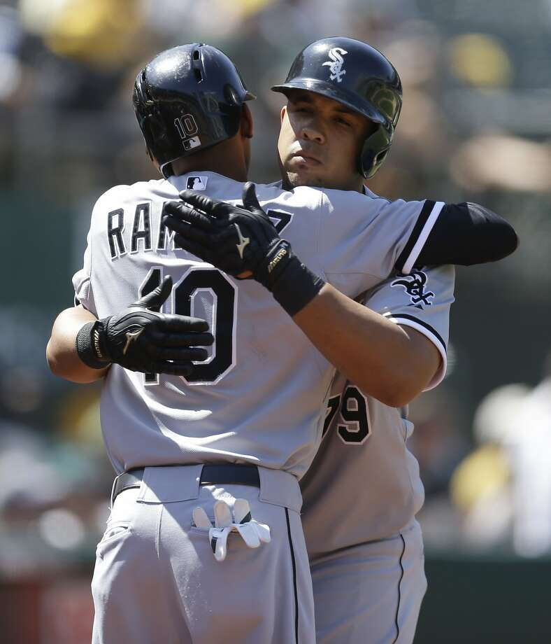 Jose Abreu gets embraced by Alexei Ramirez after his crucial three-run homer. Photo: Associated Press