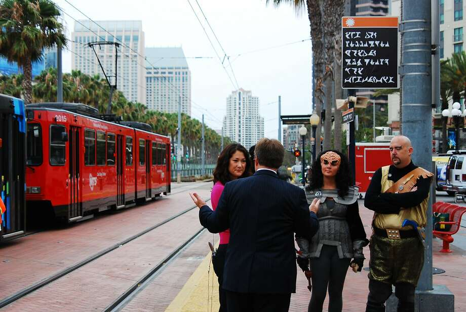 "A ""Sunshine and Superheroes"" exhibition photo indicates how San Diego's transportation agency gets into the spirit of Comic-Con, posting a trolley sign in the ""Star Trek"" Klingon language. Photo: Denis Desmond. Creative Commons"