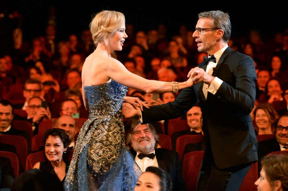 Actress Nicole Kidman (L) dances with French actor and Master of Ceremony Lambert Wilson at the Opening ceremony during the 67th Annual Cannes Film Festival on May 14, 2014 in Cannes, France. Photo: Pascal Le Segretain, Getty Images